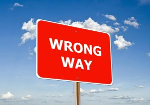 a sign that says Wrong Way
