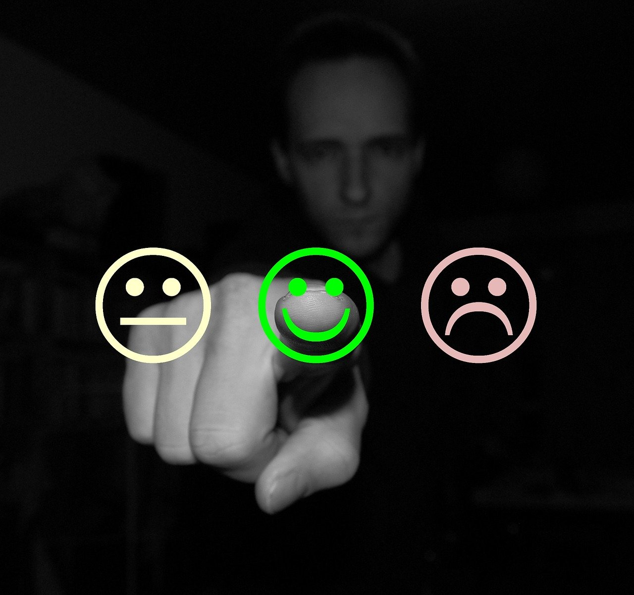 person in shadow selecting a happy face rather than neutral or sad face, leaving a positive review