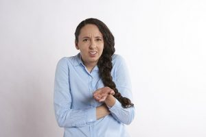 woman making an angry gesture
