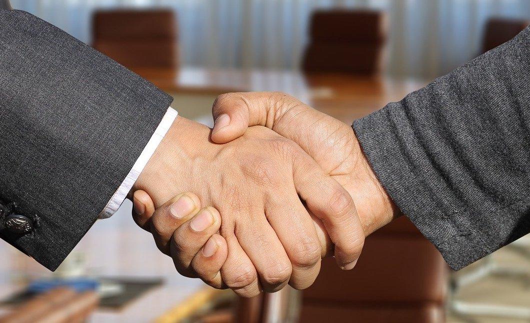 handshake representing sale of a dental practice