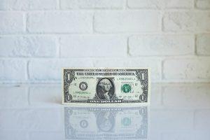 dollar bill, representing fees
