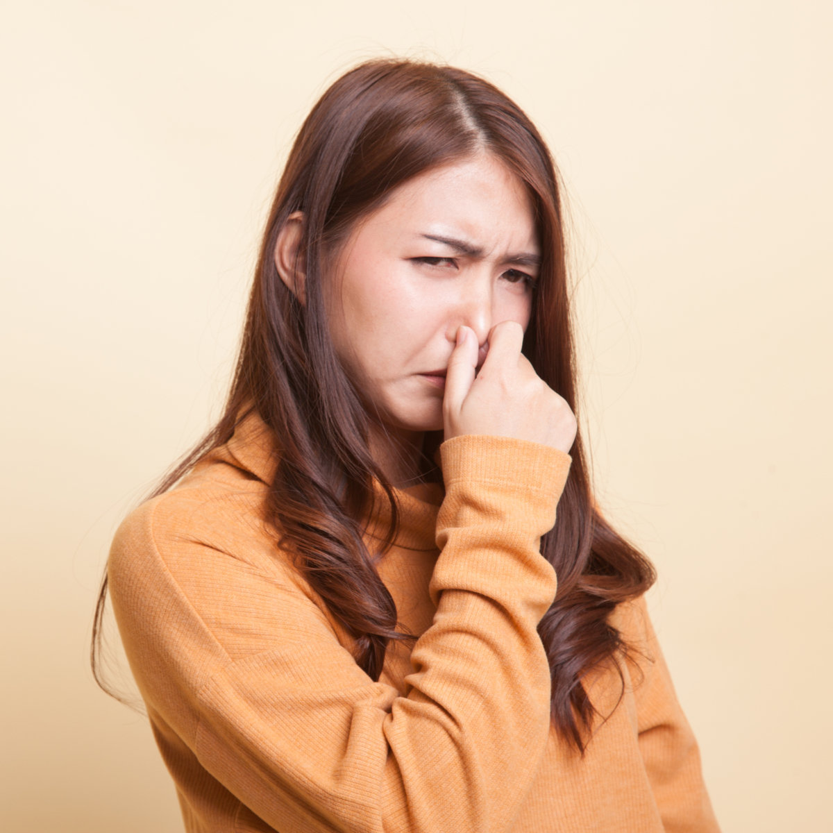 woman holding breath because hygienist has horrible breath