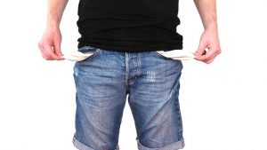 a man with empty pockets who is in debt